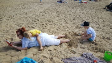 Burying Nana in the sand